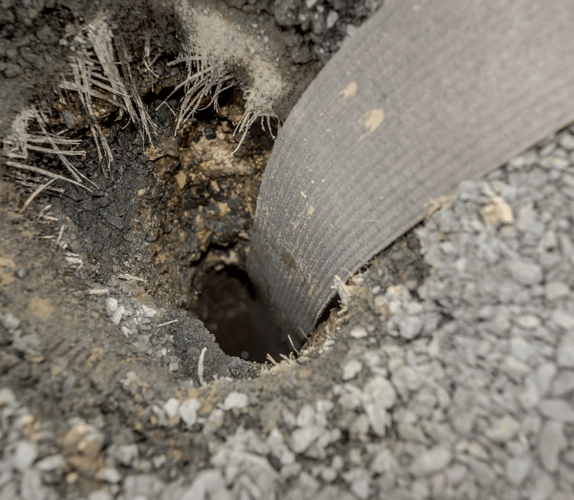 Close up of installed Colbonddrain prefabricated vertical drain installed for faster soil consolidation