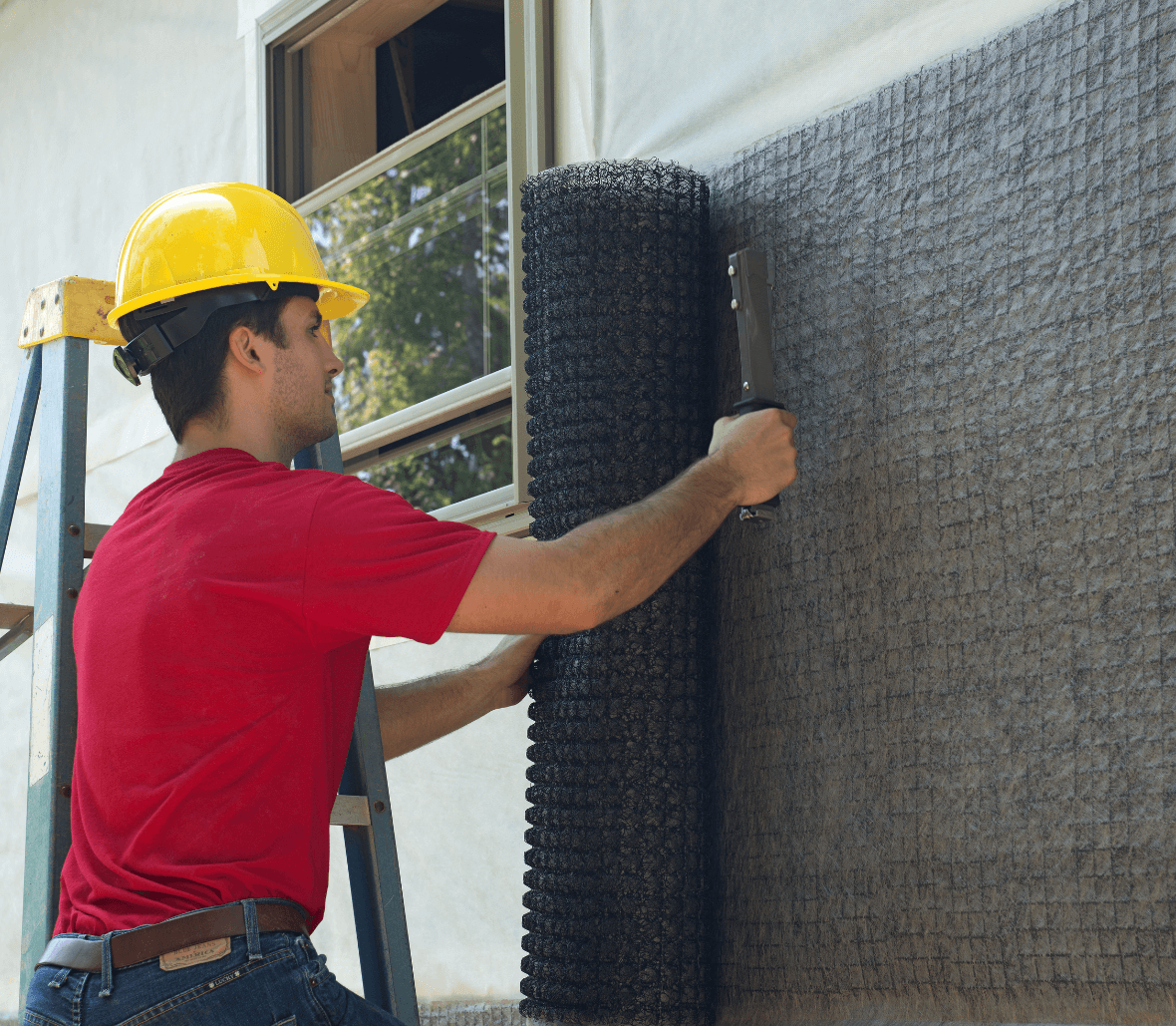 Building contractor installing rainscreen facade EnkaWallDrain on outer envelope Credits Enka Solutions_©Low&Bonar