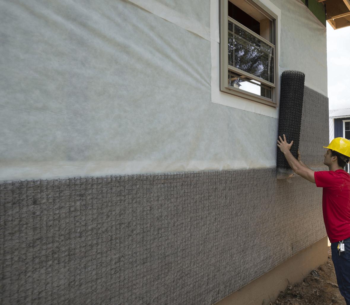 EnkaWallDrain Rainscreen system installation #1 outer wall envelope rolled out Credits Enka Solutions_©Low&Bonar